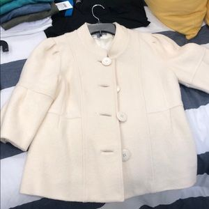Cream bell sleeved peplum coat